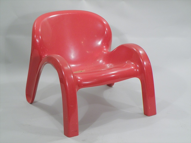 PETER GHYCZY A PAIR OF RED FIBREGLASS MOULDED CHAIRS having modular scallop arched form, model GN2 circa 1970, unmarked