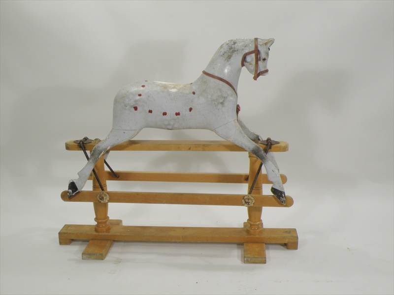 A TRIANG ROCKING HORSE Sportiboy Model 2 in unrestored condition, in galloping pose, mounted on a pine swing stand Illustrated