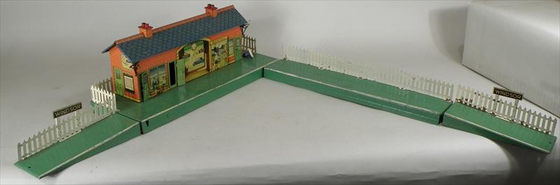 A HORNBY 0 GAUGE WINDSOR STATION & PASSENGER PLATFORM, boxed, and four various buildings, unboxed