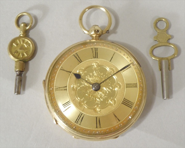 A VICTORIAN 18CT GOLD OPEN FACE POCKET WATCH having English lever mechanism with fusee faced by a gilt Roman calibrated dial, and two keys