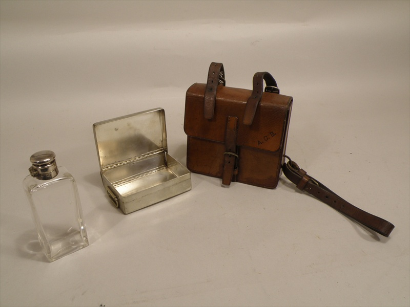 A JAMES DIXON & SON EPNS MOUNTED SPIRIT FLASK together with a nickel plated SANDWICH BOX, both contained in a stitched leather canteen, impressed Cross London and initialled A.C.B.  Illustrated