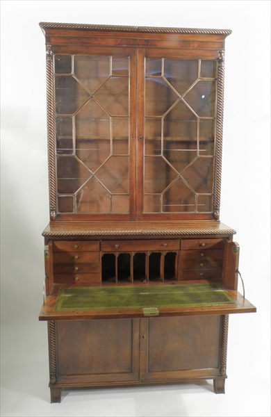 A WILLIAM IV MAHOGANY SECRETAIRE BOOKCASE, the upper section having rope carved top over twin astragal doors, flanked by rope pilasters with finials, the base with fitted drawer over twin cupboard doors, raised on splayed forefeet, 2.9m high x 1.95m wide