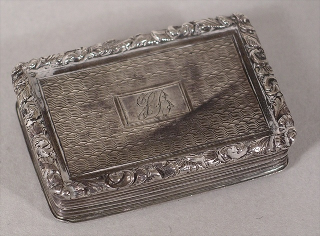 NATHANIEL MILLS A VICTORIAN RECTANGULAR SILVER VINAIGRETTE having richly cast and applied floral wire border with engine turned top and cartouche, hinged opening to reveal a gilded interior with pierced floral grille and original sponge, Birmingham1834