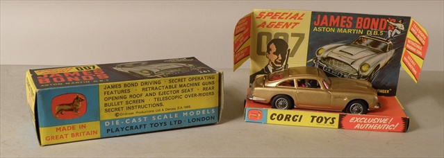 A CORGI 261 JAMES BOND ASTON MARTIN DBS (from Goldfinger), gold with cardboard stand and working ejectable baddie, bullet proof shield and machine guns, complete with secret instructions and lapel badge