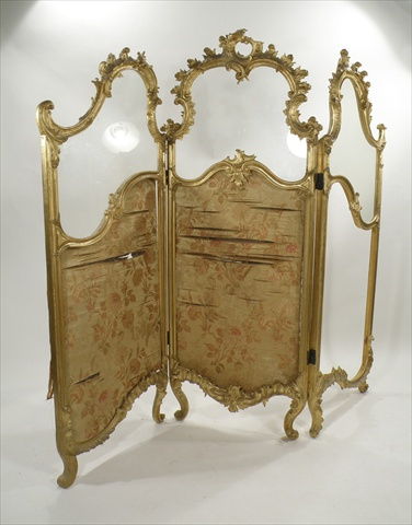 A 19TH CENTURY, PROBABLY FRENCH, CARVED GILT WOOD THREE-FOLD SCREEN ornately moulded with acanthus swags, three shaped glass upper sections over the remnants of three floral tapestry panels below, 1.62m x 1.4m (ref 14)