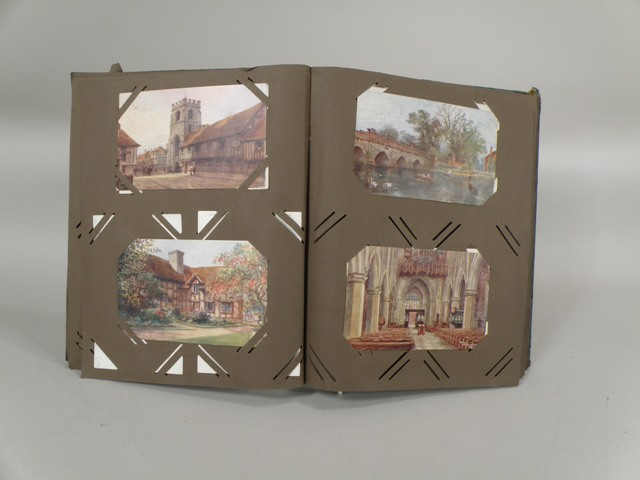 AN ALBUM OF TUCKED-IN POSTCARDS having green and gilt tooled cover, comprising approximately ninety-eight postcards all of scenes by William Wells Quatremain to include St. Marys Warwick