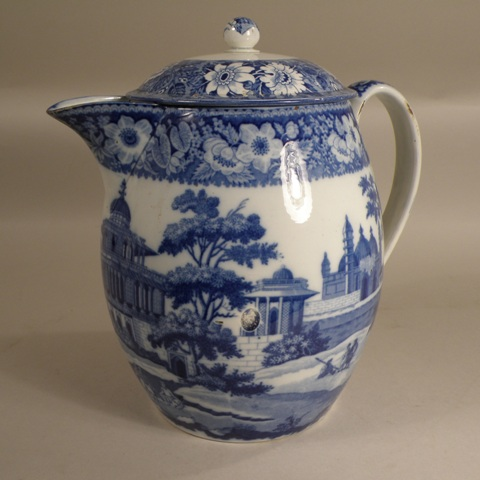 A VICTORIAN PROBABLY STAFFORDSHIRE BLUE AND WHITE DECORATED BARREL JUG decorated with a transfer of a pseudo Indian scene with figures in a Howdah in a landscape, with lid, 27cm high