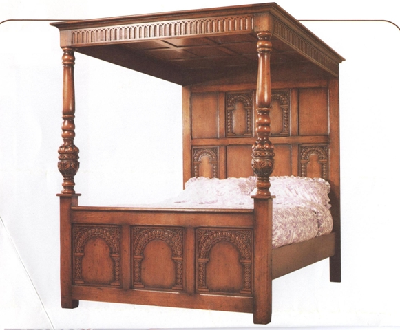 A MID//LATE 20TH CENTURY RUSTIC STYLE OAK FINISHED FOUR POSTER BED having panelled canopy with moulded pediment and fluted frieze, multi panelled head and footboards with baluster front columns, raised on stile feet