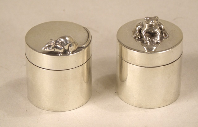 SARAH JONES TWO CYLINDRICAL SILVER PILL BOXES each having a detachable lid, one with mouse, the other a frog, London 1998