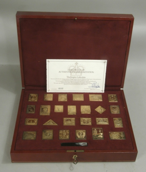 A HALLMARKED  REPLICA SET OF TWENTY-FIVE GOLD PLATED SILVER REPRESENTATIONS OF EMPIRE POSTAGE STAMPS, The Empire Collection, set no. 0532/10,000, in Morocco hide box, including key, total silver approximately 480g