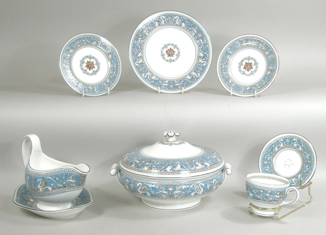 A WEDGWOOD FLORENTINE PATTERN BONE CHINA DINNER SERVICE, TOGETHER WITH TEA & COFFEE SET comprising; two vegetable dishes and covers, six dinner plates, six large and six small side plates, six dishes, a cake plate, gravy boat, six soup bowls, six sundae dishes, six of each tea and coffee cups with saucers, sugar, milk, covered sugar, teapot, coffee pot and cream jug (70-pieces)