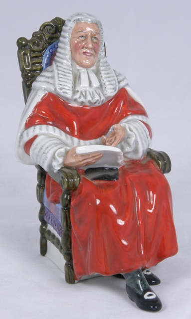 A  ROYAL DOULTON BONE CHINA FIGURE THE JUDGE, seated wigged and robed, Ref HN 2442, 15cm high