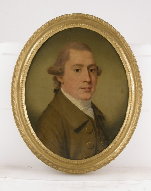 LATE 18TH/19TH CENTURY BRITISH SCHOOL A head and shoulders portrait of a young man with curled hair/wig, khaki green jacket and white cravat, Oil on Canvas, unsigned, bears label verso John Cunningham.........,36cm x 29cm, oval in gold painted gesso frame