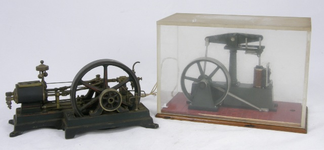 TWO SCRATCH BUILT LIVE STEAM WORKING MODELS - A DOUBLE CYLINDER HORIZONTAL ENGINE having a cast brass fly wheel and cast base, 13cm x 22cm and ANOTHER SINGLE CYLINDER ENGINE on a mahogany plinth