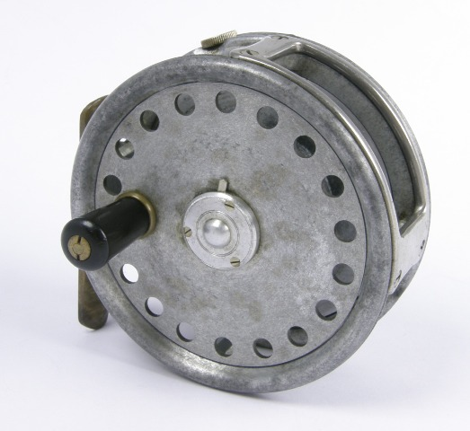 HARDY BROS LTD.  THE BARTON DRY FLY REEL, 3 1/4, having black reverse tapered handle, full width line guard, brass foot and tension regulator  The Barton reel was designed in 1934 by Dr Edwin Barton. One hundred and nine reels were made before World War II few of which have been found making this reel a highly collectable item.