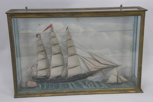 A VICTORIAN MODEL OF AN ARMED THREE-MASTED  CLIPPER in glazed cabinet, Made by J J King, 1859, 63cm x 97cm