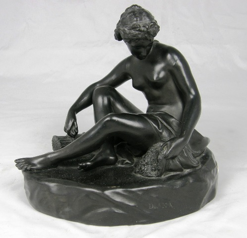 A WEDGWOOD BASALT FIGURE OF DIANA THE HUNTRESS, seated with a quiver of arrows at her feet, 26cm high