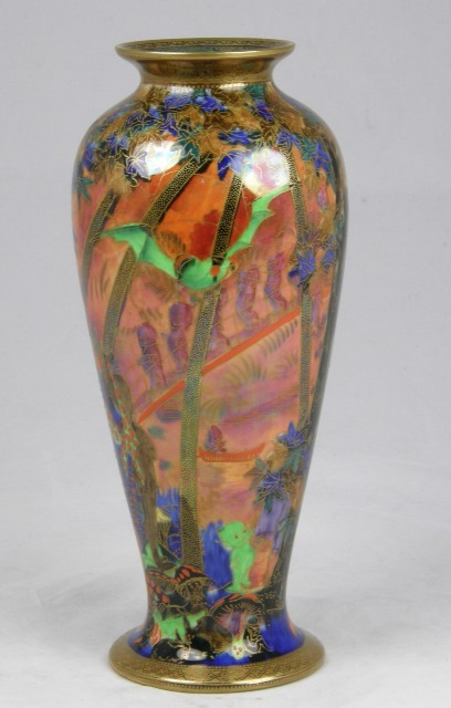 DAISY MAKEIG-JONES A WEDGWOOD FAIRYLAND LUSTRE VASE decorated with bats and elfin figures against a fiery orange ground with flowers and foliage highlighted with gilt, decorator's mark Z5360S, 27cm high