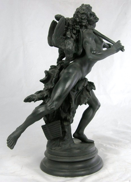 A WEDGWOOD BASALT MODEL OF A FAUN portrayed with game over his shoulder and a trunk base, on plinth, 41cm high