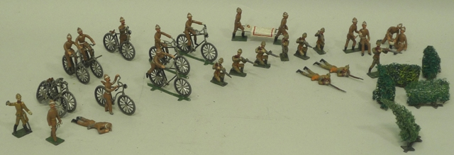A COLLECTION OF GREAT WAR PERIOD CAST AND PAINTED LEAD FIGURES, comprising a Field Station with medics, casualties and various soldiers principally dressed in khaki, some gun prone, on bicycles, medics attending to wounded, etc