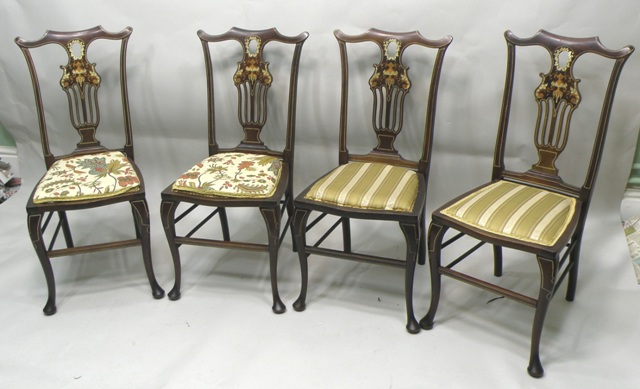 A LATE VICTORIAN/EDWARDIAN SEVEN PIECE MAHOGANY PARLOUR SUITE, each with bone inlaid tracery, pierced and carved splats, raised on cabriole forelegs, comprising a two seater settee, two carvers and four standard chairs