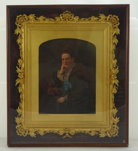 A VICTORIAN OVER-PAINTED PHOTOGRAPH OF A LADY, seated in a dark dress with her hand on her cheek, the mount signed Monsieur A. Boucher, 15 King's Road, Brighton, set in an ornate gilt gesso frame within a mahogany and glazed outer frame, 39cm x 34cm overall