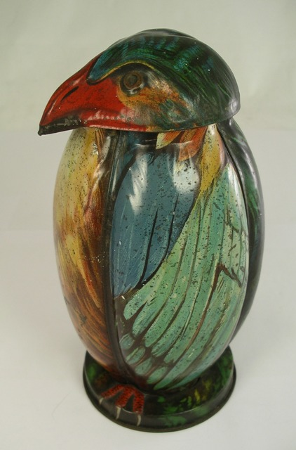 A McVITIE & PRICE BISCUIT TIN fashioned as a bird having detachable head lid and lobed bird body, plumage all over polychrome painted, 20cm high