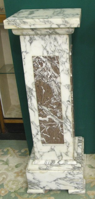 A 20TH CENTURY ITALIAN MARBLE JARDINIERE STAND having square top and squared column, richly veined with inset red marble, similarly white veined, on a moulded square block plinth with four moulded feet, 1m high x 32cm wide (The Auctioneer will give the option to purchase the following lot at the same price)