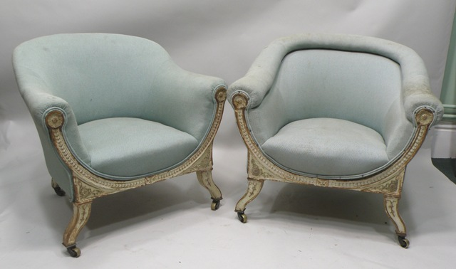 A PAIR OF LATE GEORGIAN/WILLIAM IV PAINTED SHOW WOOD FRAMED UPHOLSTERED TUB CHAIRS each in a duck egg blue upholstery with a roll upholstered crest rail and overstuffed seat, the front show wood gilded and painted with patera and incised motifs, raised on twin neck shaped and carved forelegs with brass castor terminals (ref LT131)