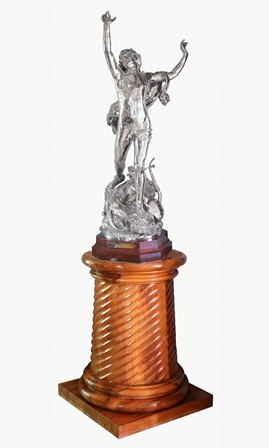 A French silver racing trophy, after Raoul Verlet 'La douleur d'Orphee', inscribed 'F. Barbedienne Fondeur', presented for Courses de Maisons Laffitte Prix Lagrange 1897, naturalistically modelled as Orpheus, standing on textured terrain effect base with three headed beast and lyre instrument,  all placed on marble canted plinth with silver plaque engraved 'Courses de Maisons Laffitte Prix Lagrange 1897', 107cm high Note: The plaster model of La douleur d'Orphee was first exhibited at the Salon of 1887 illustrated