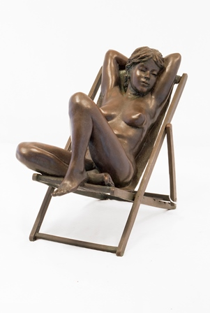 Desmond Fountain (b.1946) A bronze statue Scorcher of a young nude woman asleep in a deck chair, her arms crossed behind her head, feet up on the seat, edition 5/9, signed verso, 24cm high with certificate signed and dated 1992 illustrated