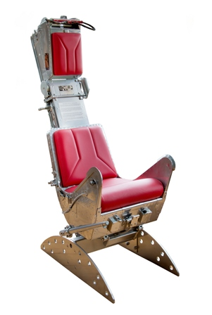 A Canberra bomber ejection seat (the Canberra was a tactical nuclear strike aircraft), polished aluminium with red leather seat, back and head pads, 1.47m high illustrated
