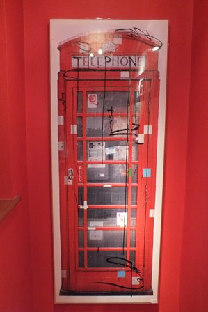 BRITISH SCHOOL, 20th century A sectionally, constructed print, of a red telephone kiosk, with graffiti marks in black and silver, in acrylic case frame, 1.67m x 64cm