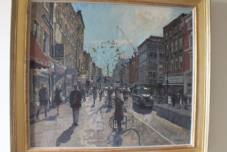 PETER BROWN, NEAC Goodge Street, London, seen in late or early sun, figures passing and window shopping, a black taxi cab and a distant crane, oil on canvas, signed and dated (20)08, 74cm x 87cm in moulded gilt frame