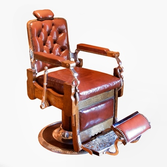 KOKE BARBERS SUPPLY CO St Louis USA A late 19th century brown leather button upholstered adjustable barbers chair with pump action, oak and chrome frame and circular base, bears manufacturers  name to the foot plates height 100 cm illustrated