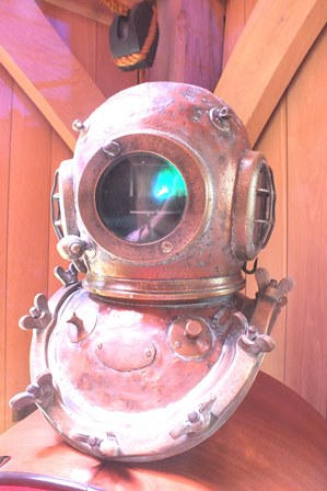 An early 20th century copper and brass deep sea divers helmet, engraved Garman and Co. Ltd., 50cm high illustrated