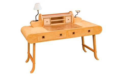 A Nigel Brown contemporary craftsman made bureau plat, having burr and figured writing surface with tambour rear superstructure, revealing pigeon holes and drawers, flanked by an electric light to one side with parchment shade, and a blacksmith made and brass dish platform night light holder to the other. Fitted two baize lined drawers with division, on trestle end supports with outswept feet, 1.51m wide, 70cm deep  illustrated