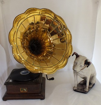 An HMV design wind-up gramophone with brass horn and cast resin Nipper, 36cm high together a small selection of 78 rpm records