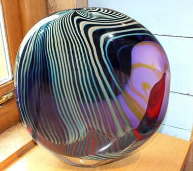 A late 20th century studio glass vase of amphora form, decorated with abstract blue, red and mauve patterns, 37cm high