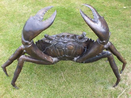 A large 20th century bronze crab in raised pose, 75cm high illustrated