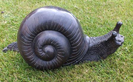 A 20th century bronze snail, some verdigris, 32cm long illustrated