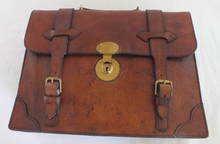 A leather briefcase made from a 200 year old Russian reindeer skin recovered from a Baltic shipwreck, made by Athene English of The English Leather Company, Hay-on-Wye, together with a card case, also stamped and dated 1786