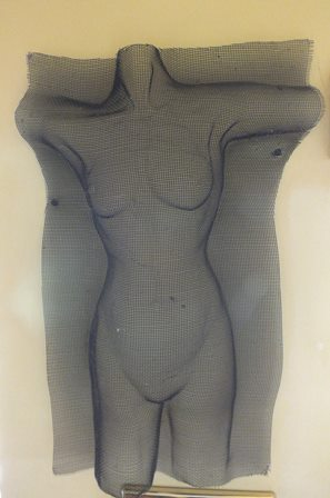 A moulded wire mesh sculpture in the form of a female torso, 38cm x 25cm