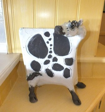 A modern studio pottery figure of a cow, crackle glazed, standing, 34cm high