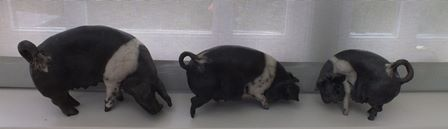 A trio of modern studio pottery pigs, indistinctly signed, 13cm high tallest