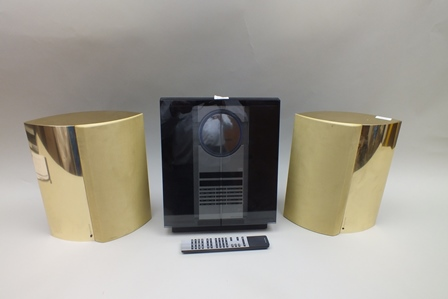 A Bang & Olufsen Beosound 3200 Radio and CD 28cm wide, with a pair of gold cased speakers and remote
