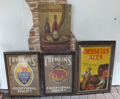 Four various vintage advertising plaques for beer