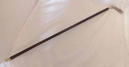 A gentlemans walking cane, having silver coloured metal dragons head handle, bearing hallmarks, 87cm long