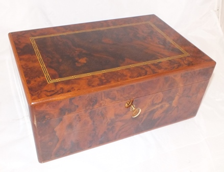 A Dunhill branded wooden cigar humidor, plus cigars within