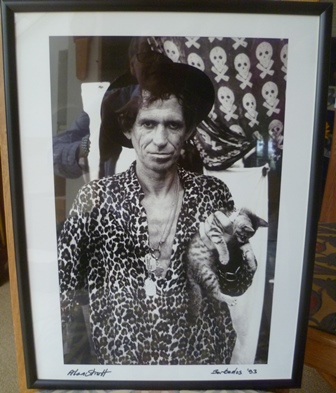 A black and white portrait photograph of Keith Richards, taken by Alan Strutt in Barbados, signed and dated 93, presentation inscription verso, 35cm x 23cm in slender black glazed frame